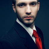 Young handsome man (businessman) in black Stock Image