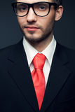Young handsome man (businessman) in black suit Royalty Free Stock Images