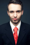 Young handsome man (businessman) in black suit Stock Photography