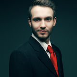 Young handsome man (businessman) in black suit wit Stock Photos