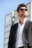 Young handsome man in career. Trendy sunglasses Stock Image