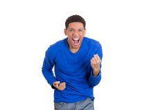 A young handsome man celebrating success, screaming with joy Stock Photography