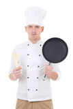 Young handsome man chef in uniform with frying pan isolated on w Stock Images