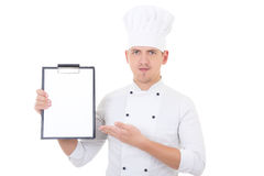 Young handsome man in chef uniform showing clipboard with copy s Royalty Free Stock Photos