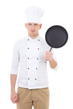 Young handsome man chef in uniform with teflon frying pan isolat Stock Photos