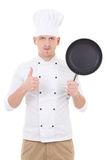 Young handsome man chef in uniform with teflon frying pan thumbs Stock Images