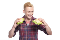 Young handsome man choosing sandwich Stock Photos