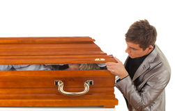 Young handsome man with coffin Royalty Free Stock Photo