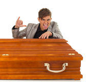 Young handsome man with coffin Royalty Free Stock Photography