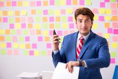 The young handsome man in conflicting priorities concept royalty free stock images