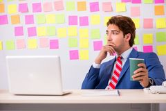 The young handsome man in conflicting priorities concept royalty free stock photography