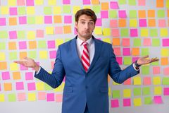 The young handsome man in conflicting priorities concept stock photography