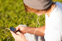 Young handsome man consulting phone outdoors Royalty Free Stock Photography