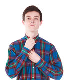Young handsome man corrects shirt isolated on white. Background Royalty Free Stock Photography