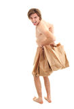 Young handsome man covering by shopping paper bags Stock Images