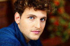 Young handsome man with curly hair Royalty Free Stock Photo