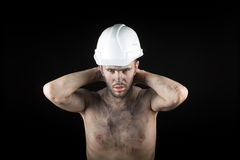 Young handsome man in a dirty helmet Royalty Free Stock Image