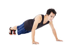 Young handsome man doing push up exercise Royalty Free Stock Photos