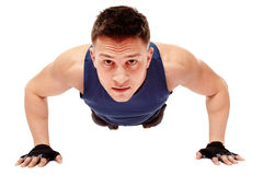 Young handsome man doing pushups Royalty Free Stock Photography