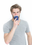 Young handsome man drink from takeaway coffee or tea cup Stock Image