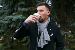 Young handsome man drinking coffee. Horizontally framed shot Stock Photography