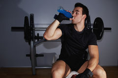 Young handsome man drinking an energy drink for continuing training Stock Photography