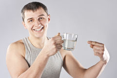 Young handsome man drinking mineral water Stock Photos