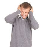Young handsome man enjoying music Stock Photography