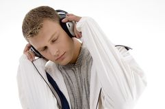 Young handsome man enjoying music with headphones Royalty Free Stock Images