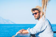 Young handsome man enjoying the view. At the beach bar Royalty Free Stock Images