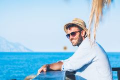 Young handsome man enjoying the view. At the beach bar Royalty Free Stock Photos