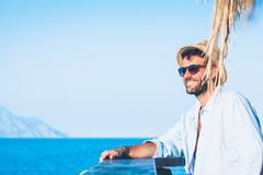 Young handsome man enjoying the view. At the beach bar Royalty Free Stock Image