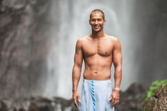 Handsome man at waterfall Stock Images