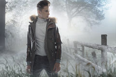 Young handsome man on the frozen meadow Stock Photos