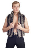 Young handsome man in fur waistcoat Stock Images
