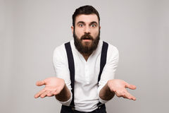 Young handsome man gesturing over white background. Stock Photo