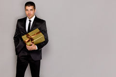 Young handsome man with a gift Royalty Free Stock Image