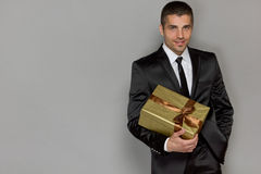 Young handsome man with a gift Stock Photo