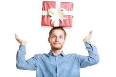 Young handsome man with a gift on his head. stock photography