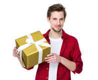 Young handsome man giving present gift box Royalty Free Stock Photo