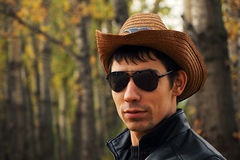 Young handsome man in glasses and a cowboy hat. Royalty Free Stock Images