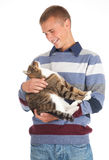 Young handsome man with grey cat Stock Photography