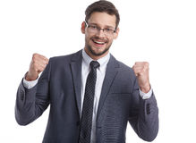 Young handsome man in grey suit and glasses smiling Royalty Free Stock Photo