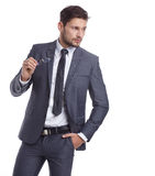 Young handsome man in grey suit and glasses smiling Royalty Free Stock Photography