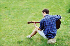 Young handsome man with guitar outdoor Stock Image