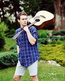 Young handsome man with guitar outdoor Stock Photo