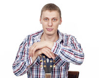 Young handsome man with guitar over white Stock Photography