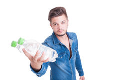 Young handsome man handing two bottles of cold water Royalty Free Stock Photos