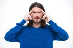 Young handsome man having headache and touching his temples Stock Images