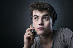 Young handsome man having a phone call Stock Photos